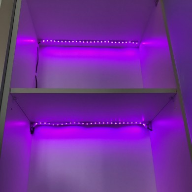 LED Strips in cabinet glowing lilac